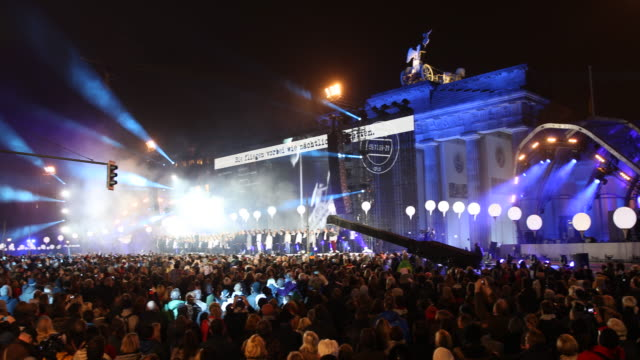 Overview of the crowd and the stage in the back of the Brandenburg Gate in Berlin in occasion of the public celebration of the fall of the Wall 25...