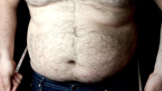 Overweight man measuring