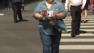 Overweight People Walking With Food