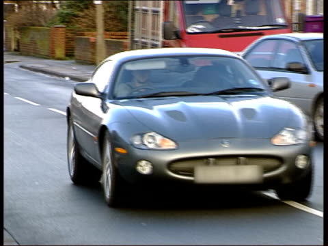 Houllier reaction ITN ENGLAND Liverpool Jaguar sports car driven by Liverpool and England footballer Michael Owen along and through gates of the the...