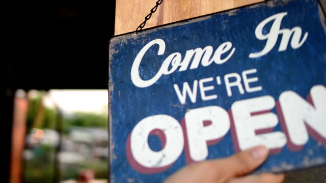 Owner opening shop -