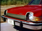 MONTAGE WS AMC Pacer driving on road/ MS front of car/ MS rear of car/ USA