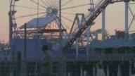 PAN Pacific Park amusement park and pier at dusk / Santa Monica, California, United States