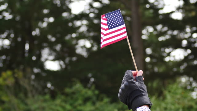 A supporter of the group Patriot Prayer holds an American flag after a press conference in Pacifica Calif Saturday Aug 26 2017 Patriot Prayer were...