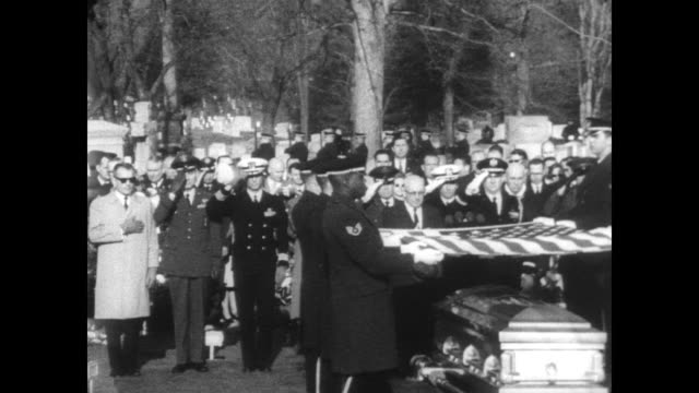 A packed Arlington Cemetery for the burials of NASA Astronauts Lt Col Virgil I 'Gus' Grissom and Lt Cmdr Roger B Chaffee / horse drawn caisson with...