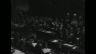 PAN RIGHT packed courtroom at Nuremberg military tribunal for Nazi war crimes / MWS high ranking Nazi officials seated in courtroom / MS front row...