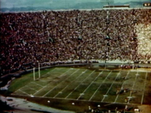 A packed football stadium during halftime