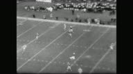 Packed stadium and marching band on field / game begins / players mentioned are Bart Starr Boyd Dowler Donny Anderson Don Chandler Johnny Unitas Alex...