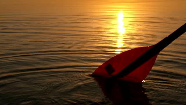 SLO MO Paddle on surface of the lake
