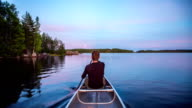Paddling a Canoe on a lake in the wilderness POV