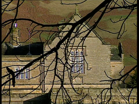 Cumbria EXT Sedbergh School seen thru trees Gates at entrance to school