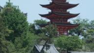 MS TU Pagoda at Itsukushima Shrine against clear sky, Miyajima Island, Japan