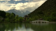 WS Pagoda by lake in mountains, Lijiang, Yunnan, China