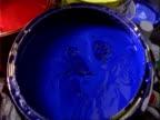 BCU Paint brush dips into blue paint pot