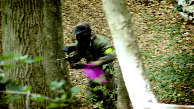 Paintball Players Capturing The Flag