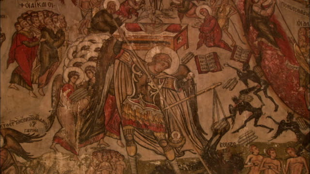 Painted murals decorate the interior walls of the old refectory in Saint Catherine's Monastery in Egypt. Available in HD.