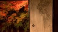 Painted sliding doors open to a beautiful autumn garden. Jisso-In Temple