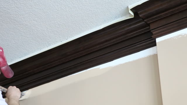 Painter Cutting in Wall to Crown Moulding
