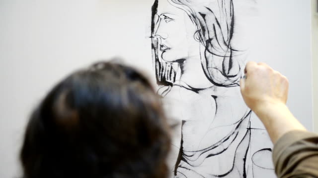 Painter drawing a woman