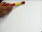 Painting red on a white background.