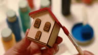 DIY: painting small wooden house roof in red