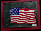 VS paintings by school children with September 11 attack as subject matter shocked face falling birds reflection of burning Twin Towers in woman's...