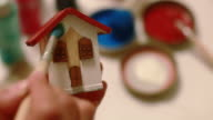 DIY: paintingsmall wooden house with paint background