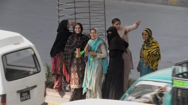 Pakistani and Afghan refugee povertystricken girls work to help their poor families to meet their needs on the International Day of the Girl Child on...