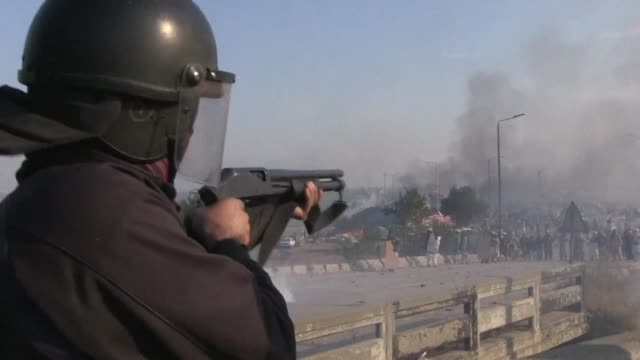 Pakistani forces fire rubber bullets and lob tear gas at protesters in Islamabad as they moved to disperse an Islamist sit in that has virtually...