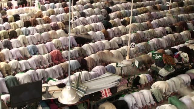 Pakistani Muslims offer Friday prayer at Faizan e Madina a Global Islamic Center at Main University Road in Karachi Pakistan