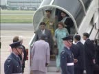 Pakistani president Pervez Musharraf is greeted at the base of his airport steps by a foreign office official at the start of a political visit to...