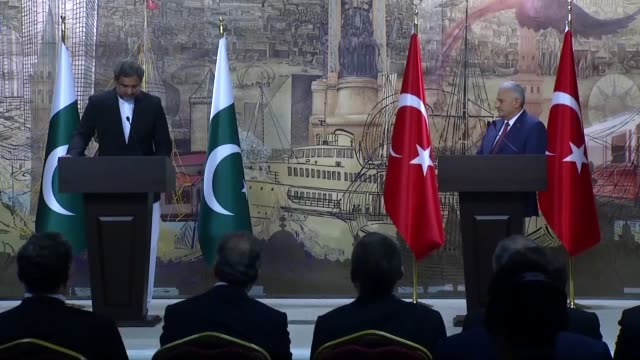 Pakistani Prime Minister Shahid Khaqan Abbasi speaks during a joint press conference with his Turkish counterpart Binali Yildirim at the Dolmabahce...