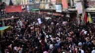 Pakistani Shiite Muslims beat themselves with chain during a mourning procession to mark the commemoration of the martyrdom of Prophet Mohammad's...