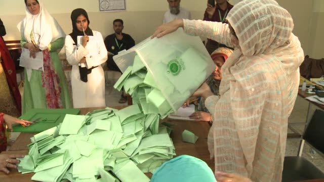 Pakistanis queued up to vote in landmark elections across the country on Saturday defying deadly Taliban attacks to take part in an historic...
