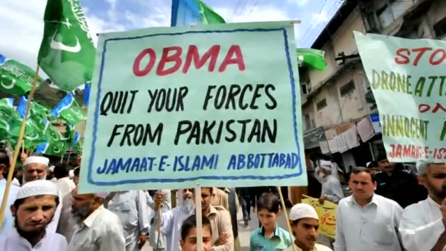 Pakistanis took to the streets on Friday cheering Osama bin Laden and shouting 'death to America' to condemn a unilateral US raid on their soil that...