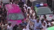 Pakistan's former Prime Minister Nawaz Sharif led a defiant procession Wednesday to his party's stronghold in the eastern city of Lahore as thousands...