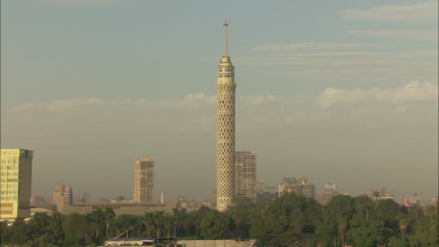 A pale yellow tower dominates the Cairo skyline.