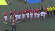 Palestinian and UAE players pose for a group photo prior to 2018 World Cup second round qualifying Group A match between Palestine and UAE at the...