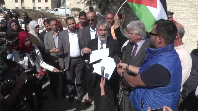 Palestinian Deputy Minister of Information Mahmoud Khalifa makes a speech outside the United Nations building during a protest organized by...