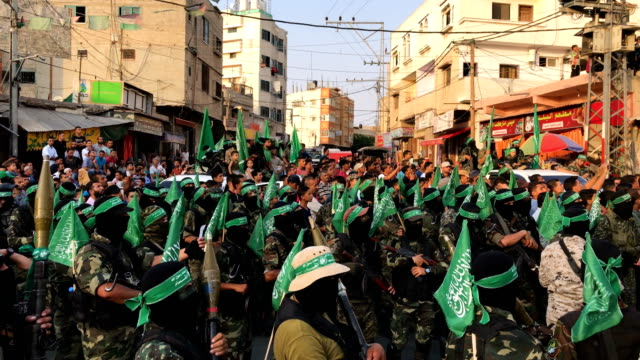 Palestinian Hamas militants are seen during a military show in the Bani Suheila district on July 20 2017 in Gaza City Gaza For the past ten years...