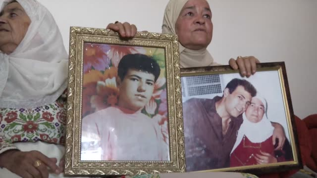 A Palestinian mother in Ramallah prepares on Monday for the return of her son promised to be released on August 13 as part of a recent Israeli...