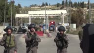 A Palestinian opened fire at a checkpoint near a Jewish settlement in the West Bank on Sunday wounding three Israelis before being shot dead...