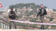 A Palestinian opened fire at Israeli security personnel at the entrance to a West Bank settlement on Tuesday killing three and wounding another...