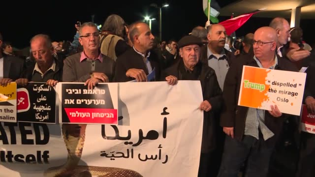 Palestinian origin Israelis hold banners during a protest against US President Donald Trump's announcement to recognize Jerusalem as the capital of...