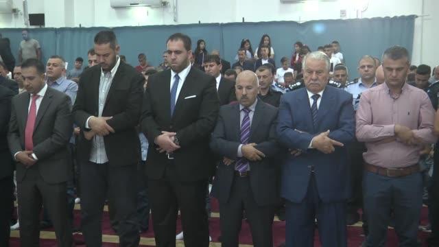 Palestinian President Mahmoud Abbas and Prime Minister of Palestine Rami Hamdallah perform the Eid Al Adha prayer in Ramallah West Bank on September...