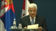 Palestinian President Mahmoud Abbas and Serbian President Tomislav Nikolic hold a joint press conference following their meeting at the Presidential...