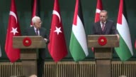 Palestinian President Mahmoud Abbas holds a joint press conference with his Turkish counterpart Recep Tayyip Erdogan after their meeting at...