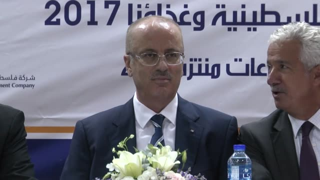 Palestinian Prime Minister Rami Hamdallah speaks at the opening of an exhibition in the Israelioccupied West Bank city of Ramallah on November 06...
