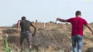 Palestinian protesters clashed with Israeli security forces near the border fence east of Jabalia refugee camp in the Gaza strip Friday in protest...
