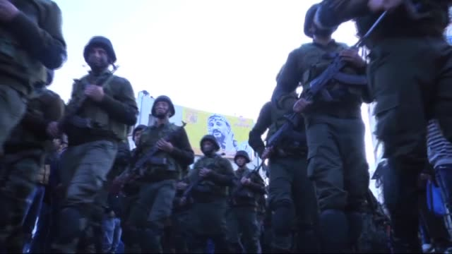 Palestinian security forces march in the streets during the ceremony for the celebration of the fiftieth anniversary of the Fatah movement foundation...